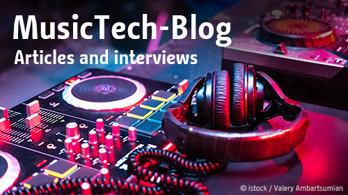 DJ music console and headphones in the light background of a club